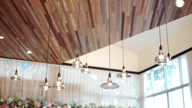 interior vintage lamps hanging from ceiling of the hotel. - wood material stock videos & royalty-free footage