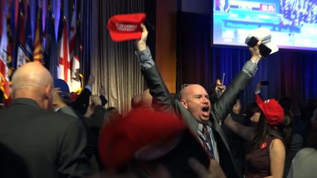 interior voxpops donald trump supporters watching us presidential election coverage and celebrating donald trump's victory before it has been... - unterstützer stock-videos und b-roll-filmmaterial