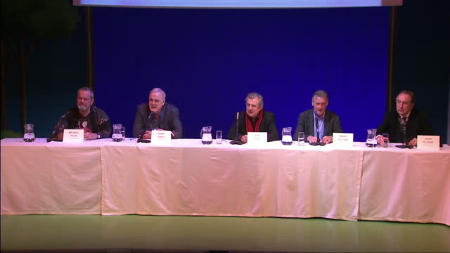 interior wide shots monty python team members sat on stage w/ eric idle answering press questio monty python stars announce reunion stage show on... - monty python video stock e b–roll