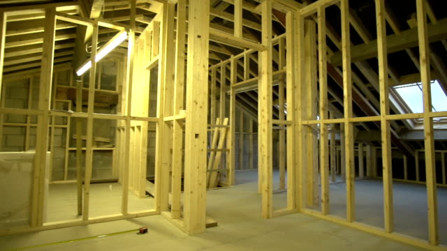interior woodwork / stud walls frame /walkthrough in new build house - doorway stock videos and b-roll footage