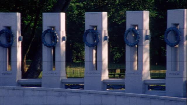PAN Interior World War II Memorial pillars w/ bronze sculptured wreaths blue shadows