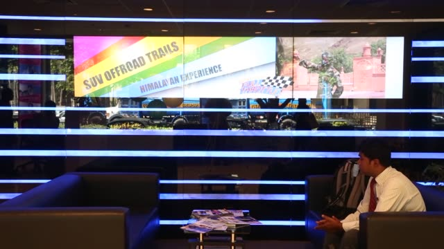 interiors and signage shots of tata motors auto show in mumbai india close ups of tata motors logo and signage in the reception area wideshots of... - limousine familienfahrzeug stock-videos und b-roll-filmmaterial