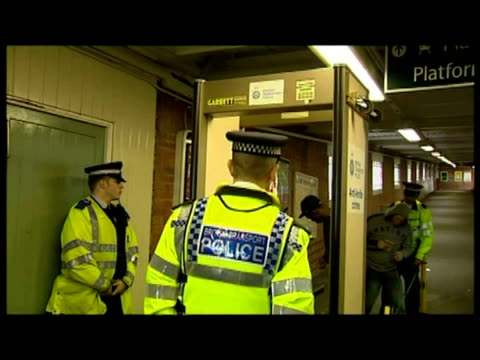 interiors british transport police officers man metal detector machine inside norbury underground station , scanning & searching passengers passing... - セキュリティスキャナ点の映像素材/bロール
