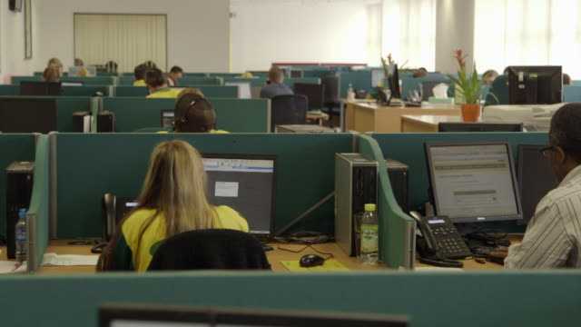 "interiors call centre - ""bbc universal"" stock videos & royalty-free footage"