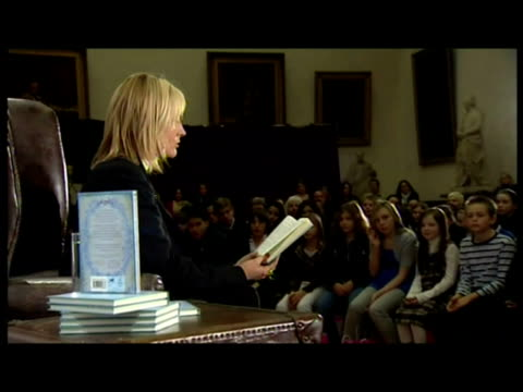interiors j k rowling reads to audience of children from her new book the tales of beedle the bard interiors rowling takes questions from children... - j.k. rowling stock videos and b-roll footage