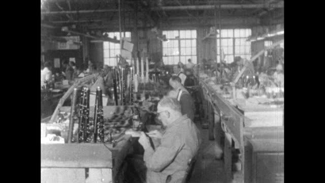 interiors musical instrument factory; 1956 - 1956 stock-videos und b-roll-filmmaterial