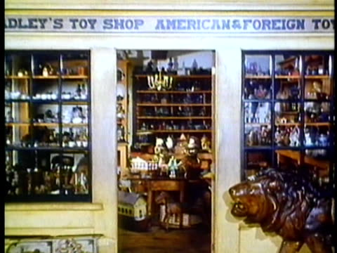 1962 reenactment montage interiors of 19th century toy shop - toy store stock videos and b-roll footage