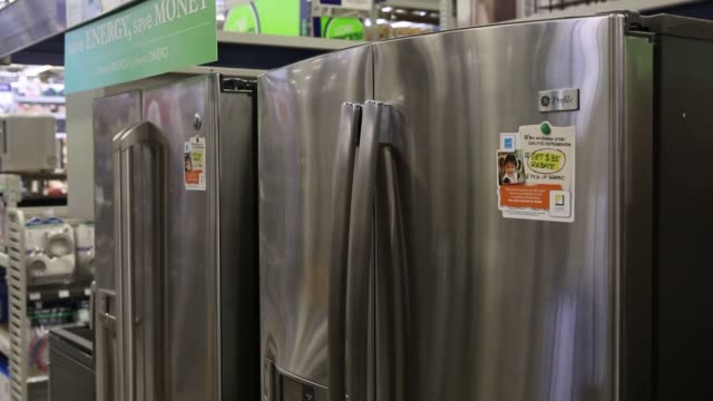 interiors of a lowes appliance store in torrance california us broll of various general electric refridgerator models for sale lowes store general... - general electric stock videos and b-roll footage