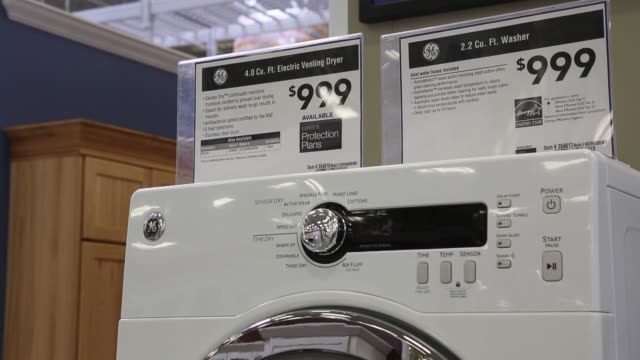 vídeos y material grabado en eventos de stock de interiors of a lowes appliance store in torrance california us broll of various general electric washer dryer models for sale lowes store general... - general electric