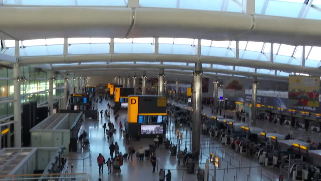 interiors of a quiet departure area in heathrow airport due to coronavirus pandemic and quarantine rules - aerospace stock videos & royalty-free footage