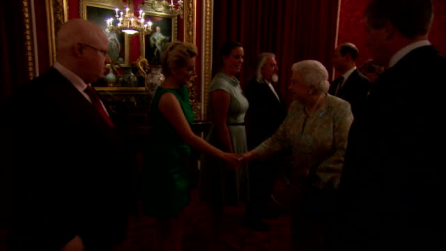 interiors of actress sheridan smith meeting queen elizabeth ii at buckingham palace on february 10 2015 in london england - sheridan smith stock videos & royalty-free footage