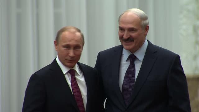 Interiors of Belarus President Alexander Lukashenko waiting then Russian President Vladimir Putin arriving and being greeted by Lukashenko on...