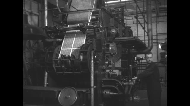 interiors of british postal service making coronation stamps / assembly line machinery with paper and stamps / men overseeing woman collating batches... - postage stamp stock videos & royalty-free footage