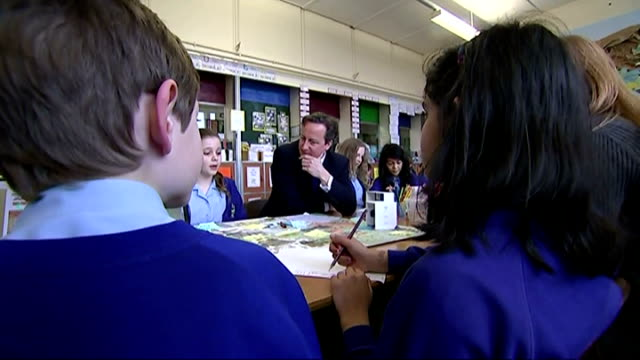 interiors of british prime minister david cameron sat at table in classroom, talking to the school children on february 09, 2015 in chester, england. - 英国チェスター点の映像素材/bロール