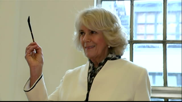 interiors of camilla, duchess of cornwall writing chinese characters guided by calligraphy painters on february 19, 2015 in london, england. - peerage title stock videos & royalty-free footage