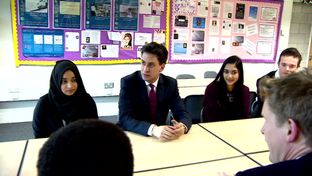 interiors of labour party leader ed miliband sat around table with haverstock school students on february 12 2015 in london england - ed miliband stock-videos und b-roll-filmmaterial