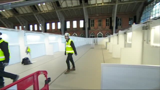 interiors of manchester nightingale nhs field hospital being fitted out to help cope with patients during the coronavirus crisis - construction industry stock videos & royalty-free footage