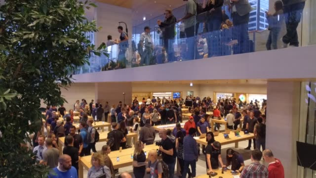 Interiors of new Apple store during the Grand Opening event in Chicago IL on October 20 2017 Photographer Dan Acker Shots wide pan left of staircase...