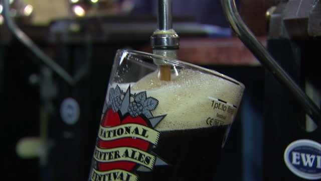 interiors of pints being poured at the national winter ales festival on february 13 2015 in derby england - ale stock videos & royalty-free footage