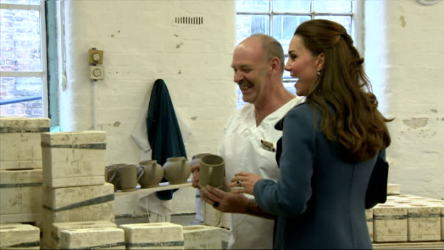 interiors of pregnant catherine, duchess of cambridge being shown mug made of clay,and sharing a joke with craftsman on february 18, 2015 in stoke,... - peerage title stock videos & royalty-free footage