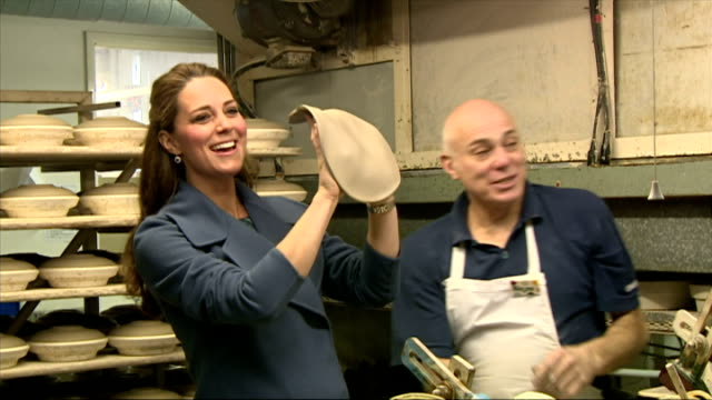 interiors of pregnant catherine, duchess of cambridge, handling flat piece of clay and throwing it down on table to great amusement on february 18,... - peerage title stock videos & royalty-free footage
