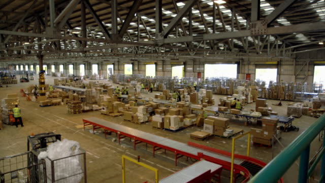 interiors package distribution warehouse - cardboard box stock videos & royalty-free footage