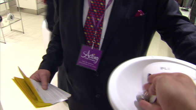 Interiors shots of Rick Wakeman as he walks over to the camera shaking a Acting for Others charity chugging box gets the cameraman to donate some...