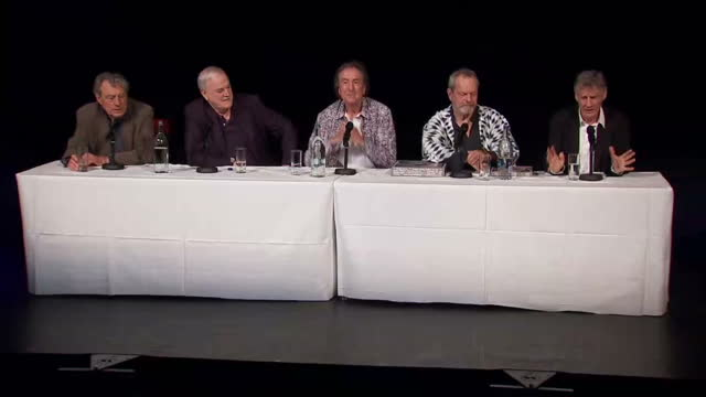 interiors showing presser from the monty python actors l to r terry jones, john cleese, eric idle, terry gilliam and michael palin - モンティ・パイソン点の映像素材/bロール