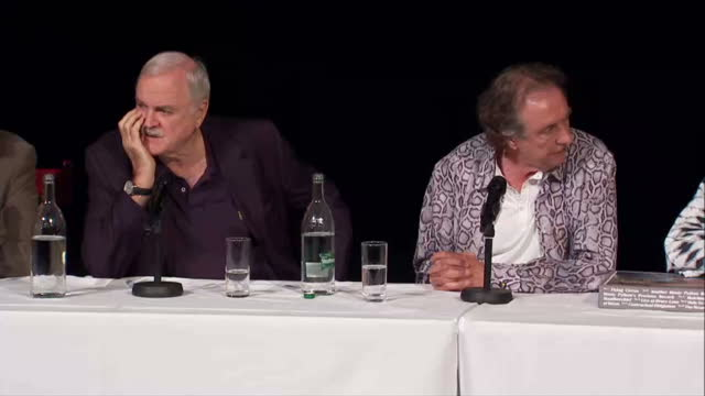 interiors showing presser from the monty python actors l to r terry jones john cleese eric idle terry gilliam and michael palin - eric idle stock-videos und b-roll-filmmaterial