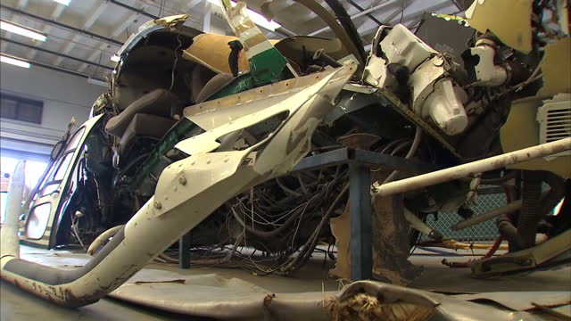 interiors shows air crash wreckage, twisted metal of planes in hanger at air crash investigation lab on march 20, 2014 in los angeles, california. - 航空事故点の映像素材/bロール