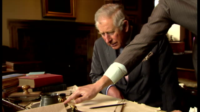 interiors shows prince charles and camilla enter kipling's writing room taking seats at his former work desk the royal pair look at some of his... - rudyard kipling stock videos & royalty-free footage