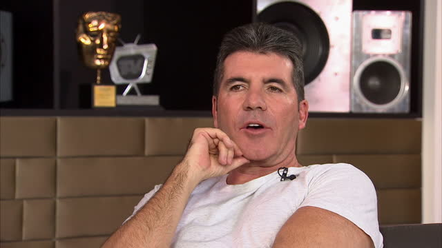 interiors shows simon cowell and harry hill on couch talking,laughing and taking questions on march 20, 2014 in london, england. - sofa stock videos & royalty-free footage