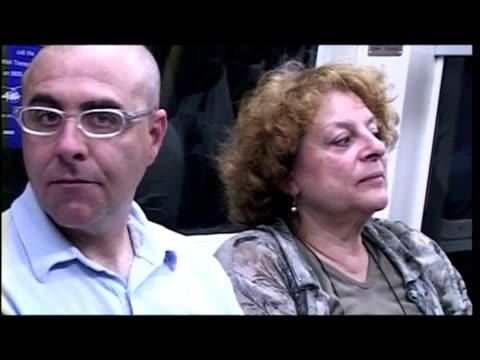 vídeos de stock e filmes b-roll de interiors var of commuters travelling on tube, busy underground - var