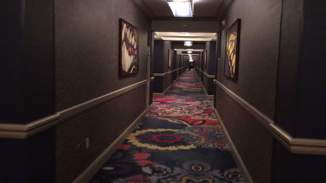 interiror shots walking along the corridor of the mandalay bay hotel casino past various hotel bedrooms on 3 october 2017 in las vegas united states - mandalay bay resort and casino stock videos & royalty-free footage