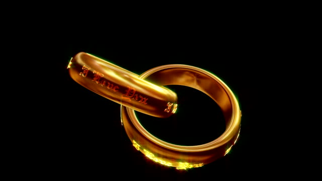 interlocked wedding rings with the text i love you revolve in front of a black background. - interlocked stock videos & royalty-free footage