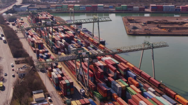intermodal shipping yard with straddle carrier - aerial view - straddle carrier stock videos & royalty-free footage