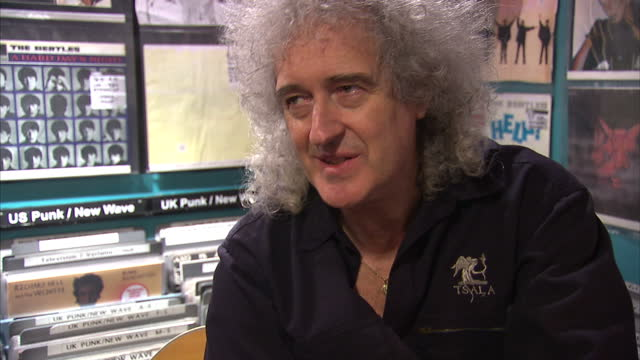 internal grab musician brian may speaking about his love of independent record shops as opposed to buying music online brian may and cerys matthews... - ミュージックショップ点の映像素材/bロール