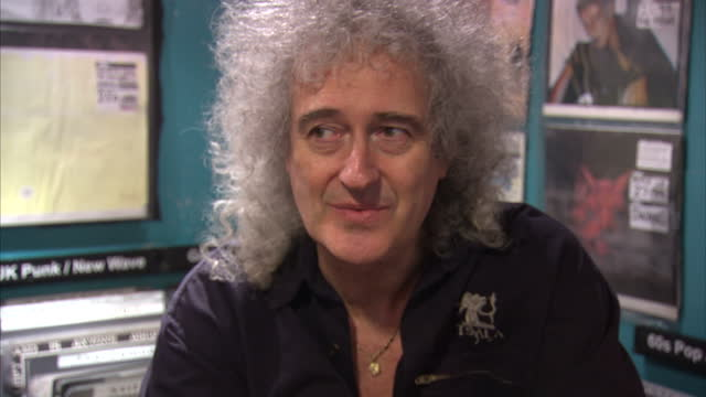 internal grab with musician brian may speaking about his new single 'the kissing song' at sister ray record store on berwick street brian may and... - ミュージックショップ点の映像素材/bロール