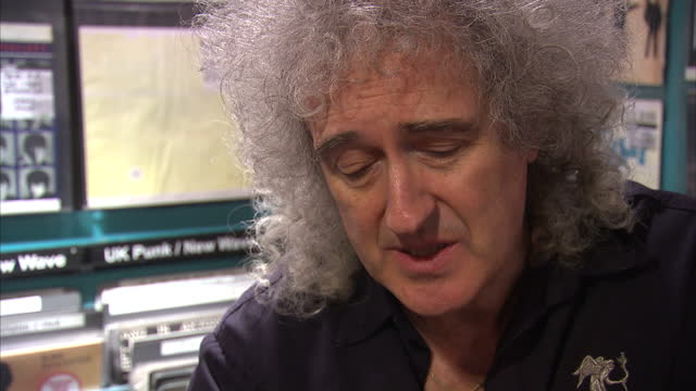 internal grab with musician brian may speaking about music piracy being unfair to musicians brian may and cerys matthews speak about their new single... - ミュージックショップ点の映像素材/bロール