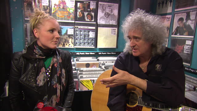 internal grab with musicians brian may and cerys matthews speaking about what makes record stores special brian may and cerys matthews speak about... - ミュージックショップ点の映像素材/bロール