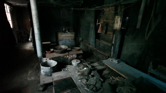 internal shot of discovery hut from kitchen to window, ross island, antarctica  - unhygienic stock videos & royalty-free footage