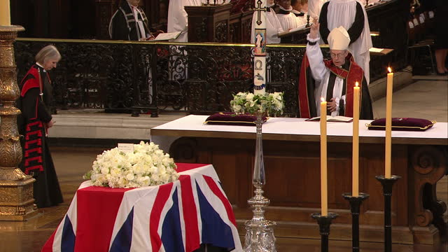 internal shot of the most reverend justin wellby, archbishop of canterbury praying and making the sign of the cross over the coffin of the late... - archbishop of canterbury stock videos & royalty-free footage