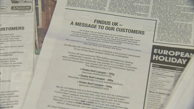 internal shots findus uk newspaper adverts in explaining its position after horsemeat was found in its products findus newspaper adverts on february... - ready meal stock videos & royalty-free footage