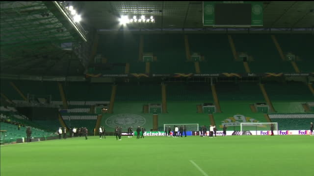 internal shots of ac milan players inspecting the celtic park pitch wearing face masks. - pitch stock videos & royalty-free footage