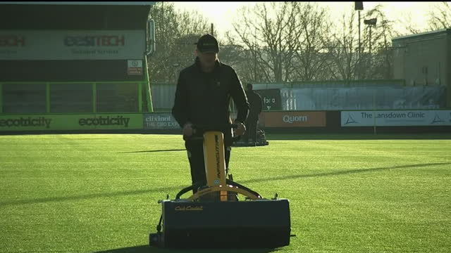 internal shots of forest green rovers groundsmen cutting the grass at the new lawn stadium. - グランドキーパー点の映像素材/bロール