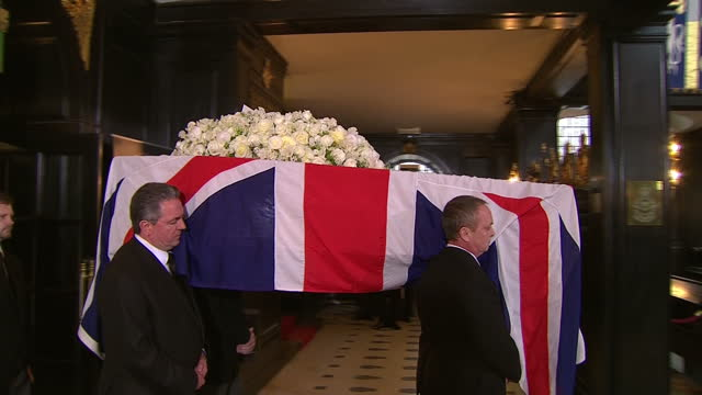 Internal shots of the coffin of the late Baroness Thatcher being carried into the Church of St Clement Danes on The Strand for a short service before...