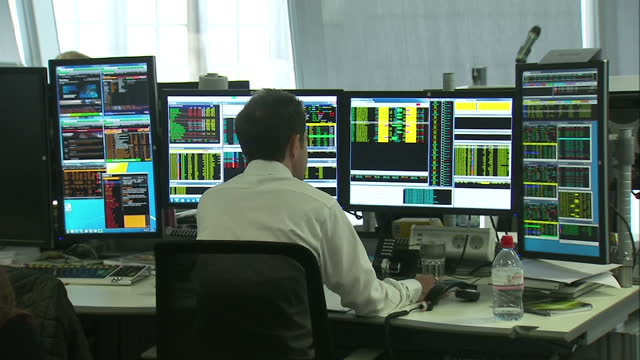 internal shots of traders on the panmure gordon trading floor shows interior shots of anonymous trader working at his desk on december 17 2014 in... - bull market stock videos & royalty-free footage