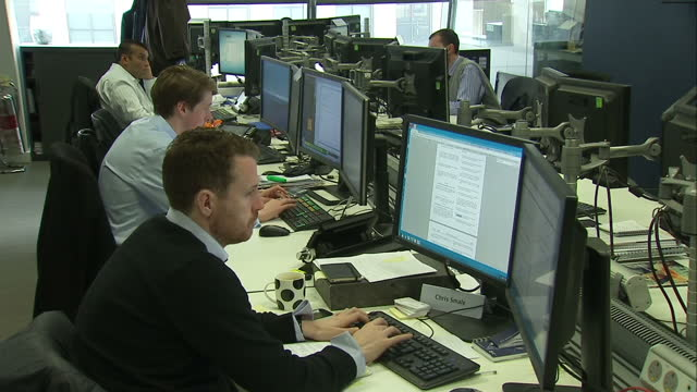 Internal shots of traders on the Panmure Gordon Trading Floor Shows interior shots of Traders working at their desks on December 17 2014 in London...