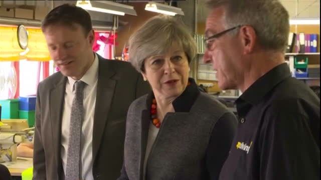 internal shots prime minister theresa may visits ap diving in helston talks to workers smiling and laughing view from above as she walks downstairs... - cornovaglia video stock e b–roll