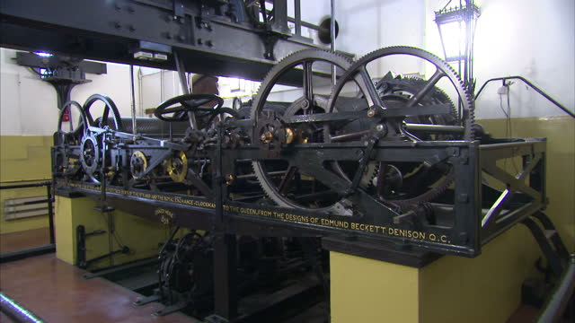 internal shots various of big ben's mechanism, the great clock machine, auto-winding mechanism moving, going train, chiming train, striking train in... - big ben stock-videos und b-roll-filmmaterial